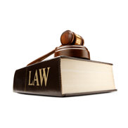 Judge's gavel on top of a law book